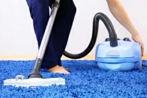 Vacuum cleaner in action-men cleaner a carpet